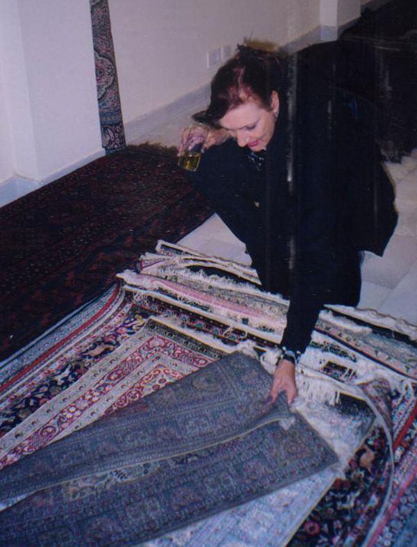 Jane choosing her favorite rug for the bedside