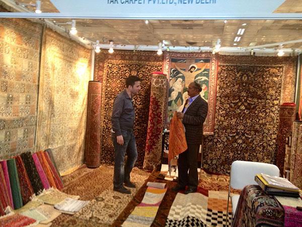 Mr. Falk learning the art of carpet making from Mr. Daniel