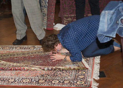 Carpet connoisseur counting the number of knots per square inch