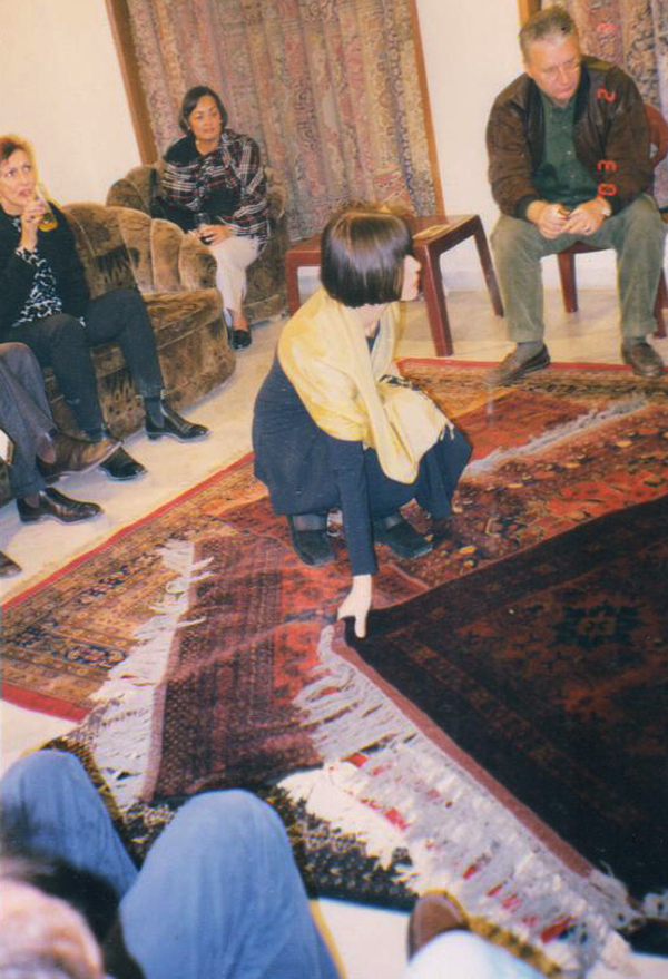 Mrs. Berry inquisitive about the art of carpet making