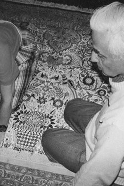 Mr. Talwar overlooking Colleen sign her new silk rug to be shipped to her hometown in NY(1991)